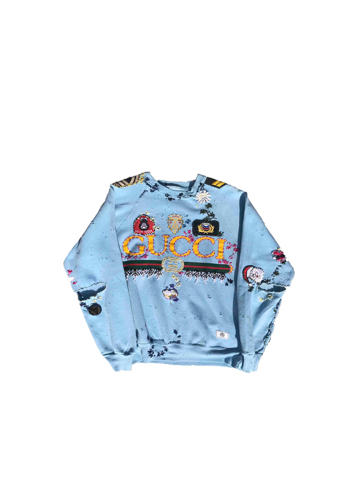 GUCCI // BABY BLUE CREW NECK WITH STITCHING AND PATCHWORK DETAIL
