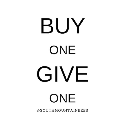 This sign reads BUY one GIVE one and it means that each time you buy one of our soaps, we donate a soap to the homeless in our community