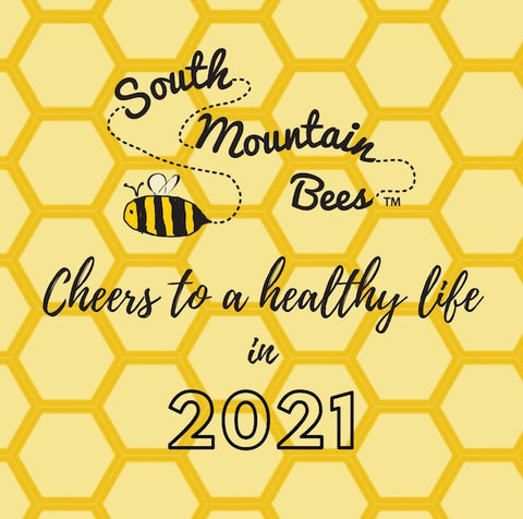 "on a honeycomb background there's the South Mountain Bees logo  and ""Cheers to a healthy life in 2021""."