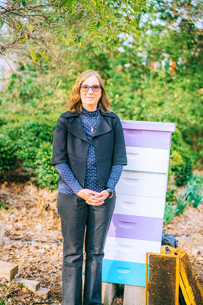 Adriana Compagnoni is the owner and beekeeper of South Mountain bees. Here you can see her in her apiary.