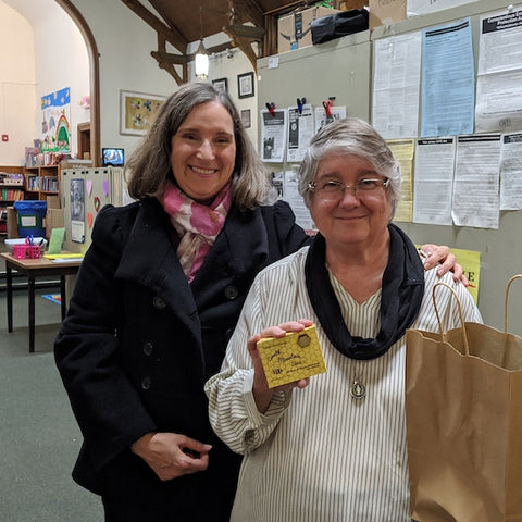 Adriana Compagnoni, the beekeeper from South Mountain Bees, with Linda Flores-Tober, Director of the Elizabeth Coalition to House the Homeless holding a the soaps when they were donated to the Coalition.