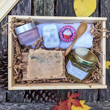 The Giving Gift Set is the top of the line.  It contains: moisturizing cream with Shea butter, beeswax and vitamin E, raw honey scrub with bamboo spoon, handcrafted honey soap, beeswax lip balm, soothing salve, beech wood soap dish, and a hotel grade 100% cotton washcloth,  in reusable sliding top wooden box.