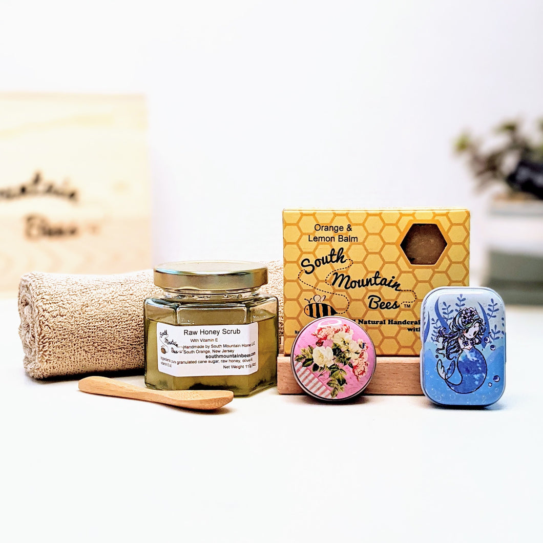 The Retreat Dream Box is filled with skin pampering products: a raw honey scrub with bamboo spoon, a soothing salve, two of our best selling products: a honey soap and a lip balm, a beech soap dish, and a hotel quality 100% cotton washcloth.