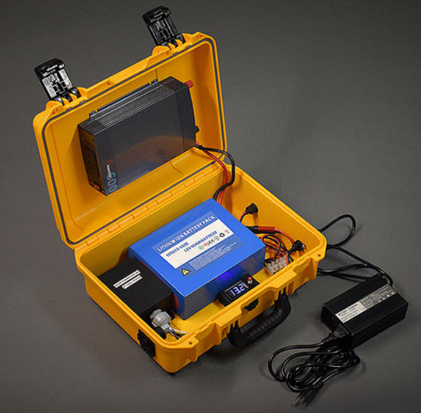 The Dynamo AC 600 provides a lightweight portable high capacity 12V battery pack with 600 watt pure-sine wave invertor and maximum power point tracking (MPPT) solar charge controller available in both a hard and soft case.  The Dynamo 600 AC can be used in many situations including; Emergency Response, Field service, Un-attended Remote Sensing, Remote Welding, and Overland Exploration. These and other activities need to operate essential appliances such as refrigerators, power tools, LED lights, laptop computers, sat and smartphones, and handheld radios. The Dynamo AC 600 can help accomplish this and much more…