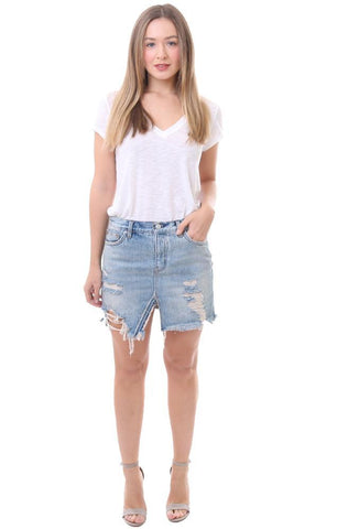 a9eed61b6 Take trendy spring styles to the max with this Free People split front skirt  in a light wash blue. The slit in this relaxed fit denim mini makes it  ultra ...