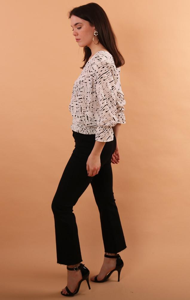 banded black white v neck blouse