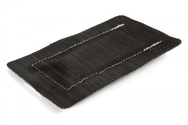 Dapper pouches have hard-side Velcro on one side, allowing them to be installed on any soft Velcro area.