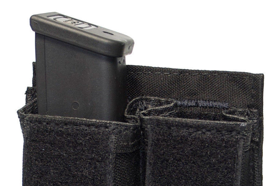 Velcro flaps are removable to make an open top mag pouch. Mags are held in place with elastic retention.
