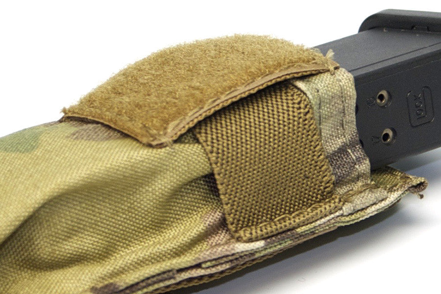 Elastic retention holds pistol mag in place when top flap is removed. Works as an open top mag pouch.