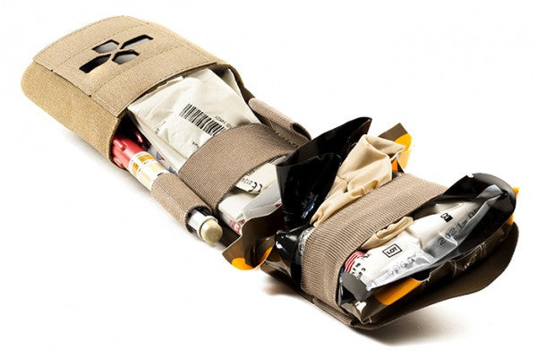 Once free of the outer pouch, the supplies carrier unfolds to give immediate access to the trauma supplies within.
