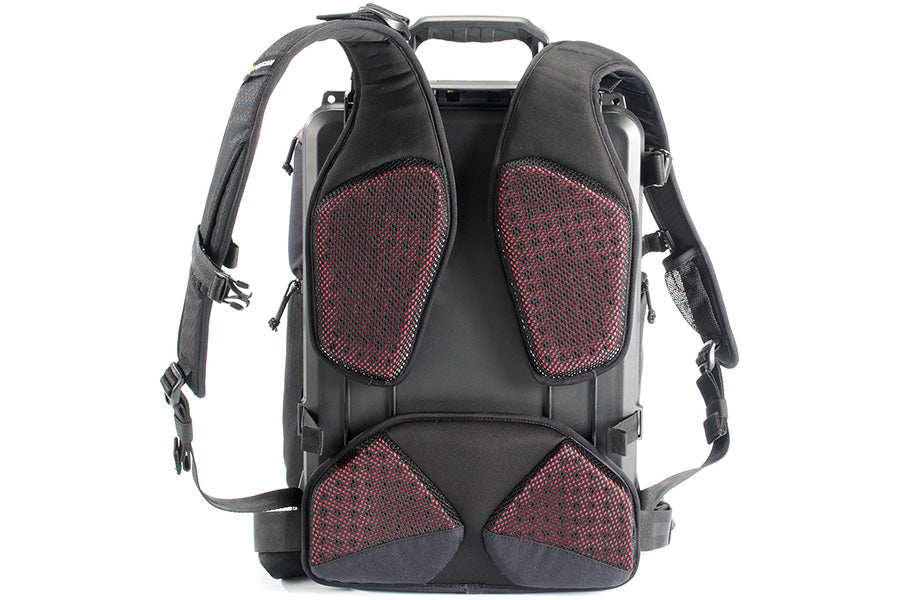 Floating ergonomic lumbar/shoulder strap design and ventilated back panel