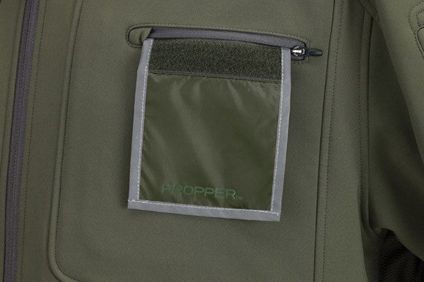 Hidden badge panel stays in its own pocket on the left chest until you need to show it.