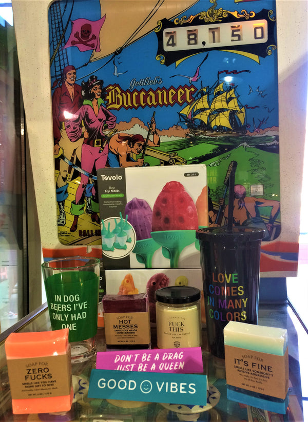 Examples of Blue Banana Market gift products displayed on a pinball machine