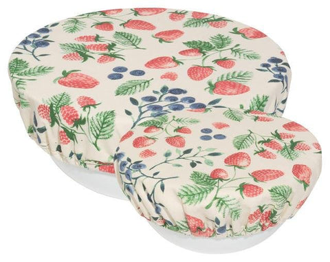 2 cloth bowl covers, white with pattern of strawberries, blueberries and green leaves, on a large and a small white bowl.