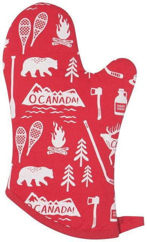 "Red oven mitt with white illustrations of Canadian icons (snowshoes, camp fires, hockey sticks, mountain ranges with ""O Canada!"" written on them, etc.)."