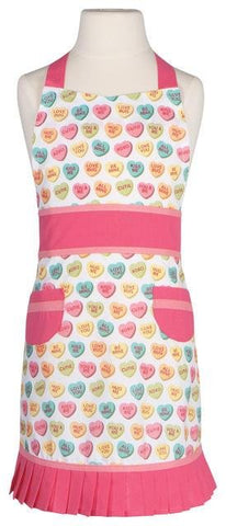 White apron with pink accents, including front aprons and pleats. Pattern of pastel sweet heart candies.