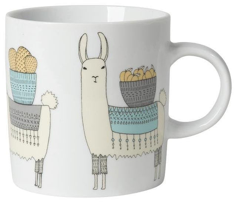 White mug with illustrations of llamas carrying baskets of cargo on their backs.