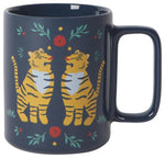 Black mug with illustration of two tigers facing each other and red flowers, green leaves, and yellow stars.