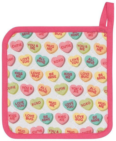 "Pot holder with design of sweet heart candies against white background. Pink trim. Candies contain messages like ""XOXO,"" ""Be Mine,"" etc.."
