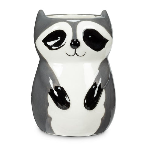 Ceramic planter shaped and painted like a cute cartoon raccoon.