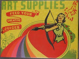 "Lid of vintage style tin box in primary colors with illustration of a woman holding a bow and ""arrow"" with a paint brush as the arrow and a rainbow shooting from the brush's tip. Green letters at top right read ""Art Supplies,"" red banner underneath with yellow letters read ""Freed Your Creative Juices."""