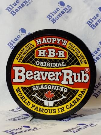 "Lid of Haupy's Beaver Rub Seasoning, Original blend. Text around edge of label reads ""Please Rub Responsibly,"" ""Not For Use On Live Beaver,"" ""World Famous in Canada."""