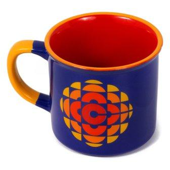 Ceramic mug shows retro orange and yellow CBC logo against dark blue background. Light orange accents, dark orange inside cup.