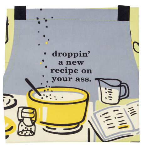 "Front of apron, grey with white and yellow illustrations, reads ""droppin' a new recipe on your ass."""