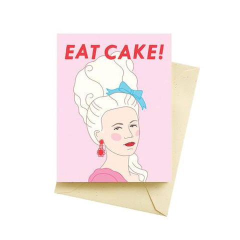 "Front of card with illustration of Marie Antoinette's head and shoulder. Pastel pink background, red text reading ""Eat Cake!"""