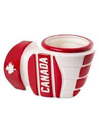 Ceramic mug shaped like hockey glove gripping cup. White with red accents.