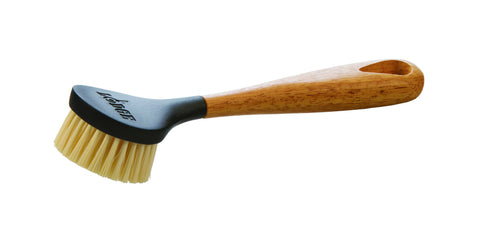 Lodge scrub brush with rubber wood handle, black plastic head, and nylon bristles.