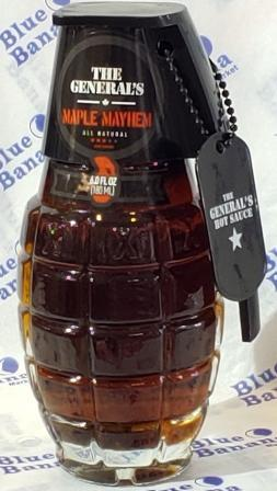 "Clear glass bottle of Maple Mayhem The General's Hot Sauce, shaped like hand grenade. Black lid with military ""dog tag"" featuring company logo."