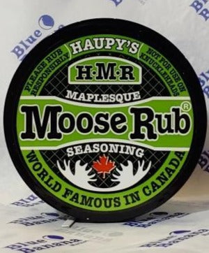 "Lid of Haupy's Maplesque Moose Rub Seasoning. Text around edge of label reads ""Please Rub Responsibly,"" ""Not For Use On Knuckleheads,"" ""World Famous In Canada."""