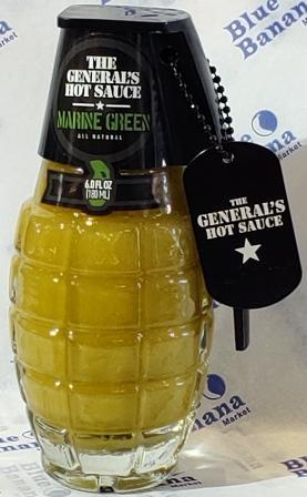 "Clear glass bottle of Marine Green The General's Hot Sauce, shaped like hand grenade. Black lid with military ""dog tag"" featuring company logo."