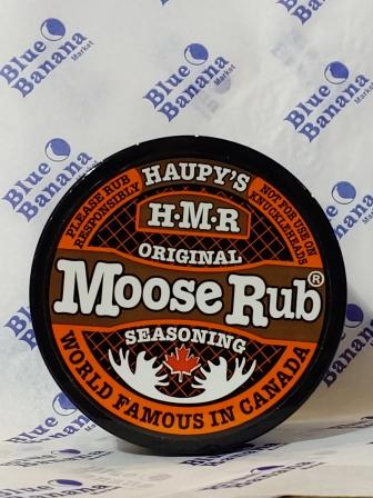 "Lid of Haupy's Moose Rub Seasoning, Original blend. Text around edge of label reads ""Please Rub Responsibly,"" ""Not For Use On Knuckleheads,"" ""World Famous In Canada."""