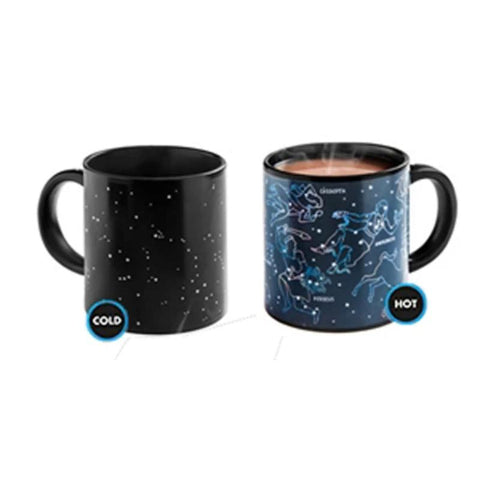 Image of Starry Night Morph Mugs in Cold and Hot states. Cold mug shows constellations as pinpoints against black, hot mug (containing steaming beverage) shows constellations as classical figures, with their names.