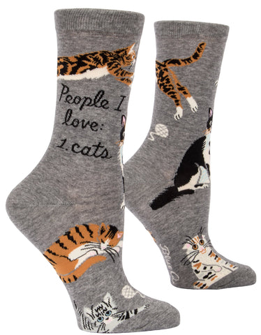 "Side view of grey socks with orange, black, and white images of cats and text in script that reads ""People I love: 1. cats."""