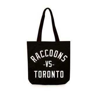 "Black tote bag with white lettering on the side that reads ""Raccoons -VS- Toronto."" Lettering is attention grabbing, filling up entire side."