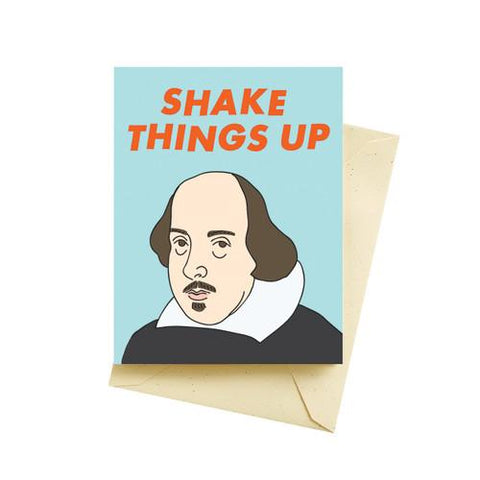 "Card on top of cream colored envelope. Front of card features illustration of Shakespeare against pale blue background. Orange text at top of card reads ""Shake Things Up."""