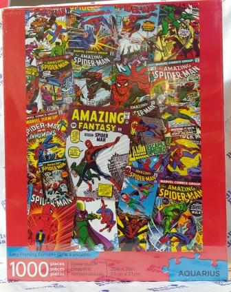 Cover of puzzle box shows 1000-piece puzzle featuring Spiderman comics covers throughout the years.