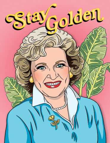 "Front of card with illustration of smiling Betty White in front of palm fronds and words ""Stay Golden"" in golden lettering. Pale pink background, pale blue sweater and gold earrings and brooch on Betty."