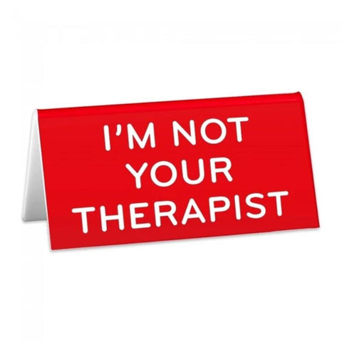 "Red desk sign with white text reading ""I'm Not Your Therapist."""