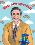 "Front of card with illustration of smiling Mr. Rogers and X the Owl. Blue sky background with white clouds and mini rainbows. Red test over Mr. Rogers' head reads ""You are special!"""