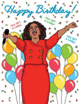 "Front of card with illustration of Oprah in red suit, holding microphone, shouting with her arms thrown out, against a white background with colorful confetti and balloons. Script at top of cards reads ""Happy Birthday!"" Around Oprah's head is the phrase ""You Get A Card!"" repeated three times."