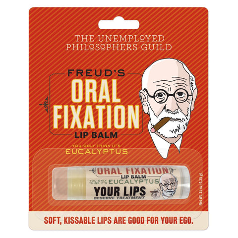 "Red/orange package containing The Unemployed Philosophers Guild's Freud's Oral Fixation Eucalyptus Lip Balm. Text at bottom of package reads ""Soft, Kissable Lips Are Good For Your Ego."" Lip balm tube is white with red/orange and black text. Both package and tube feature illustration of Freud with cigar."