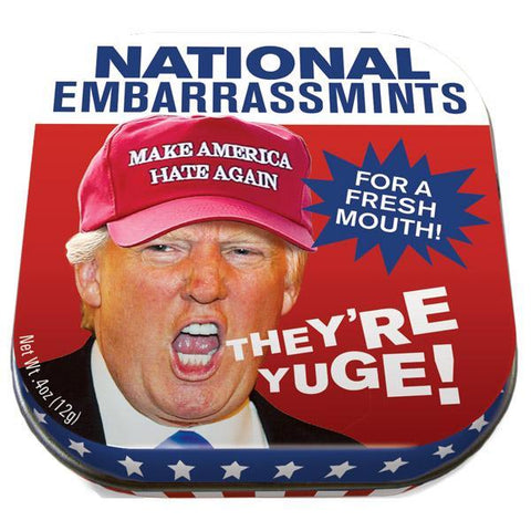 "Red, white and blue mint tin with picture of Donald Trump wearing a red hat that says ""Make America Hate Again"" and the words ""They're Yuge!"" coming out of his mouth. Text in blue ""explosion"" box reads ""For A Fresh Mouth!"""