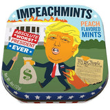 "Mint tin showing cartoon image of Donald Trump in front of a White House on fire, carrying a bag of money and a burning copy of the Constitution. To the left, a hand holds a red, white and blue picket sign saying ""Absolute Worst President Ever."" Text at top of tin reads ""Impeachmints."" Text at top right reads ""Peach Flavored Mints."""