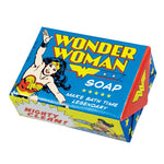 "Bar of Wonder Woman soap in package. Red, white, blue and yellow color scheme. Front of package shows Wonder Woman flying and the Wonder Woman logo; text at bottom right: ""Make Bath Time Legendary."""