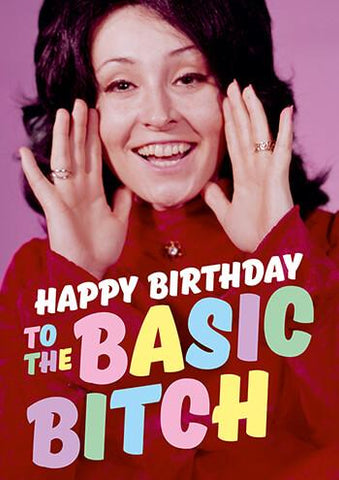 "Front of card with retro image of brunette woman in red sweater, smiling, with hands on either side of face to broadcast message. Text reads ""Happy Birthday To The Basic Bitch"" in pastel colors."