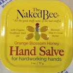 Top view of tin of The Naked Bee Orange Blossom Honey Hand Salve For Hardworking Hands. Yellow tin with black, orange, and red lettering and stylized bee emblem.
